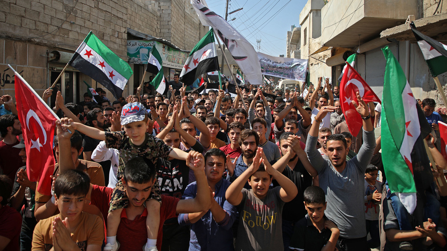 Photo of Idlib demonstrators proclaim Syrian revolution far from over