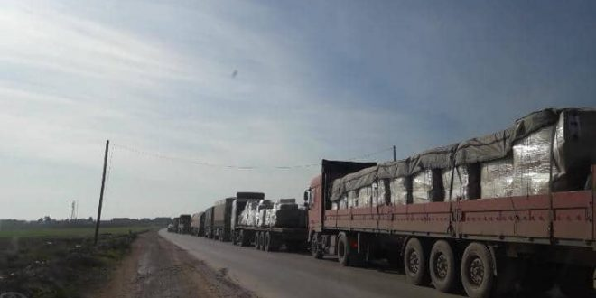 Photo of A shipment of aid from the International Alliance arrives in the kobani countryside coinciding with immunization of America headquarters