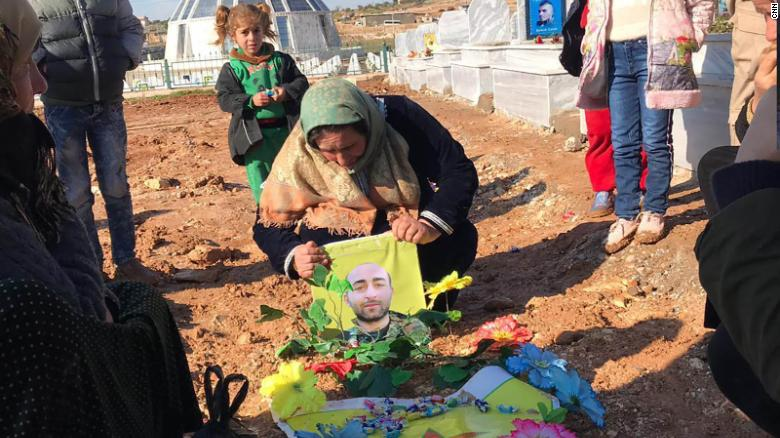 Photo of In a Syrian cemetery, Kurds contemplate war without their US allies