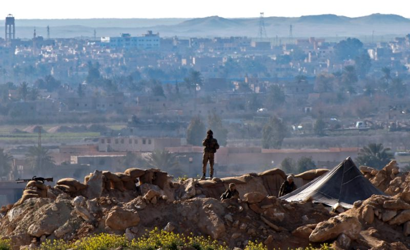 Photo of IS defends last Syria redoubt, as family members flee
