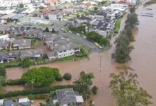 Photo of Australia evacuates thousands of people in its worst floods in half a century